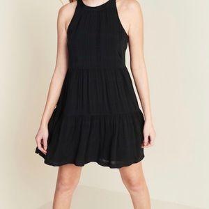 Black sleeveless tiered dress
